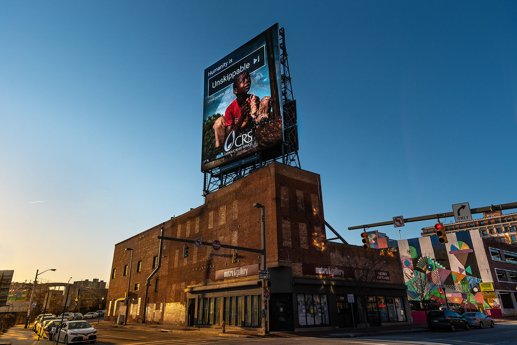 catholic relief services unskippable billboard in baltimore, part of the unskippable marketing campaign